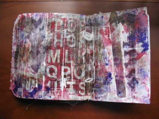 My cover made from the packaging from an Amazon purchase. The plastic rings I used on the binding were spacers from a spindle of CDs.