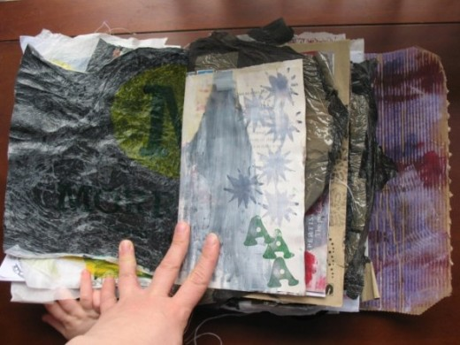 Page taken from an altered book and plastic from a trash bag.
