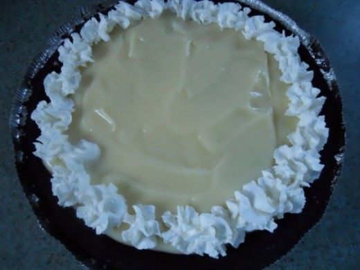 Put little puffs of whipped cream all around the edges.