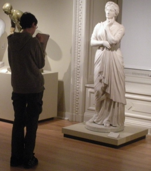 Here he is sketching Il Penseroso, a marble statue created by artist Joseph Mozier based on the allegorical figure of Melancholy in John Milton's 1632 poem of the same name.