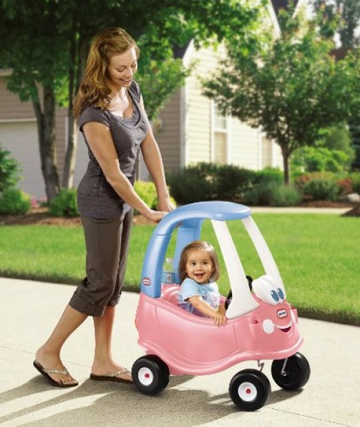 For a younger toddler, you can help by pushing the little tikes cozy car