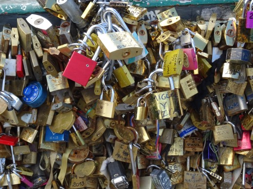Love-locks on the bridge now come in layers - a massive burden for the bridges to bear - too much love in Paris.