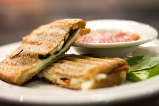 Cheese, pepperoni, black olives, and a side of tomato sauce in this pizza panini.