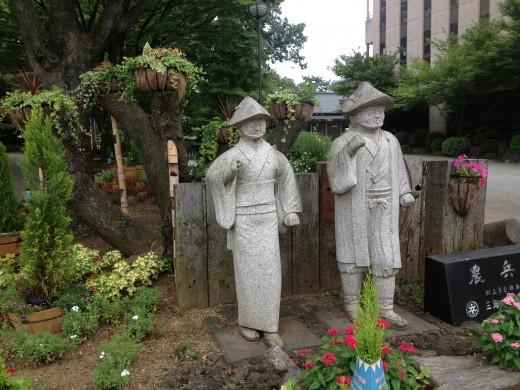 Statues outside a park.