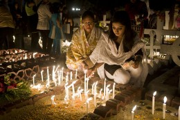 Halloween Bangladesh. People dress up in real nice clothing and go set at the graves of their dead relatives lighting candles on the graves and visiting with the dead relatives.