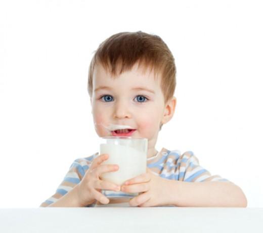Child Enjoying Yogurt