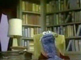 Alistair Cookie, played by Cookie Monster, appears with the disputed pipe
