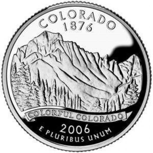 Colorado's state quarter features Longs Peak.
