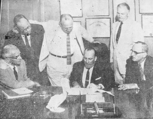 Jack Gremillion (seated, center) and other coastal states AGs