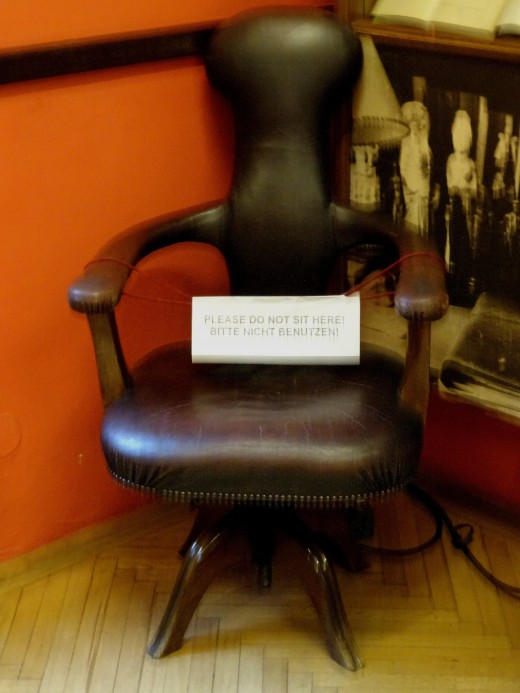 The unique reading chair that Freud had specially design and made to suit his unusual posture when reading.