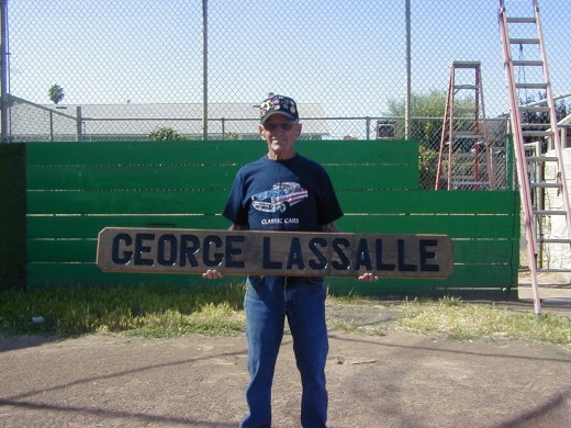 My Dad with the sign that graces the ball field named in his honor.