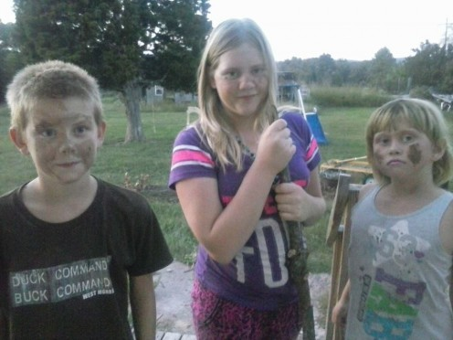 "Michaela in ""war paint"" with her brother, Jackson and sister, Alana"