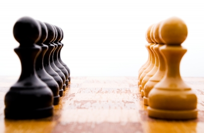 Opposing chess pieces on a chess board
