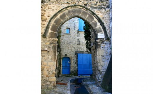 Blue shutters seen through an archway