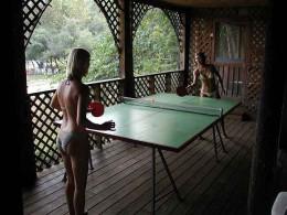 Girls playing table tennis.
