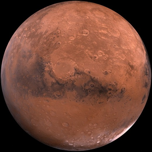 Mars, The Red Planet. The redness is caused by by iron oxide, which is essentially the same thing as rust on Earth.  So maybe Mars should be known as the rusty planet?