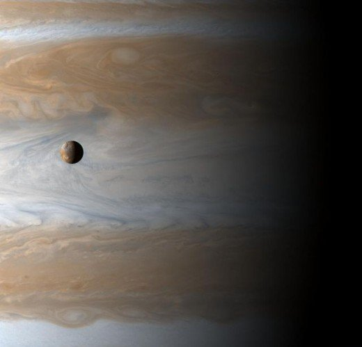 Image of Jupiter and Io captured on January 1, 2001 by Cassini.  Io is the planet's largest moon, but the photo demonstrates the enormous size discrepancy between the two bodies.