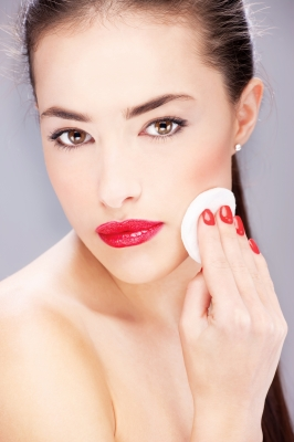 Applying foundation with a round, classic cosmetic sponge