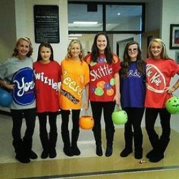 A group of girls dressed up as their favorite candy.