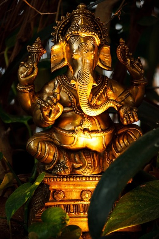 Statue of the Hindu god, Ganesha.  Unlike Christianity, Judaism, and Islam, which believe in one god, Hinduism is polytheistic, which means that there are many gods.