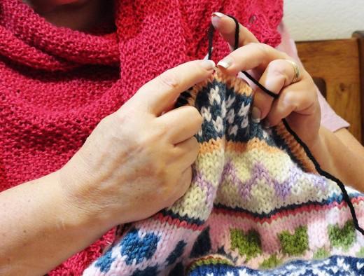My hands knitting Fair Isle pattern.
