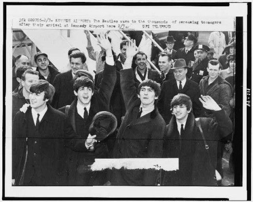The Beatles arrive at Kennedy Airport on a cold, windy day in February, 1964