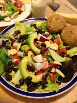 A Better-Than-Fast-Food Salad of avocado, black beans, fresh greens and vegetables, thrown together in less time than it takes to go through a drive-thru