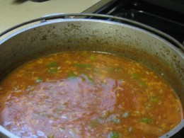 Add uncooked rice to simmering soup.