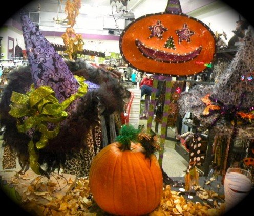 Halloween decorations fill a store window