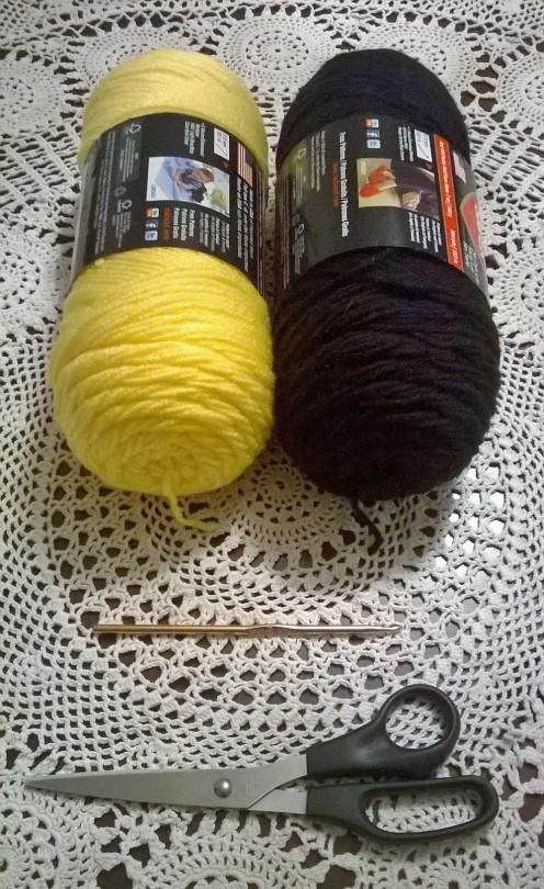 One skein yellow yarn, one skein black yarn, one US size G crochet hook, one pair of scissors.