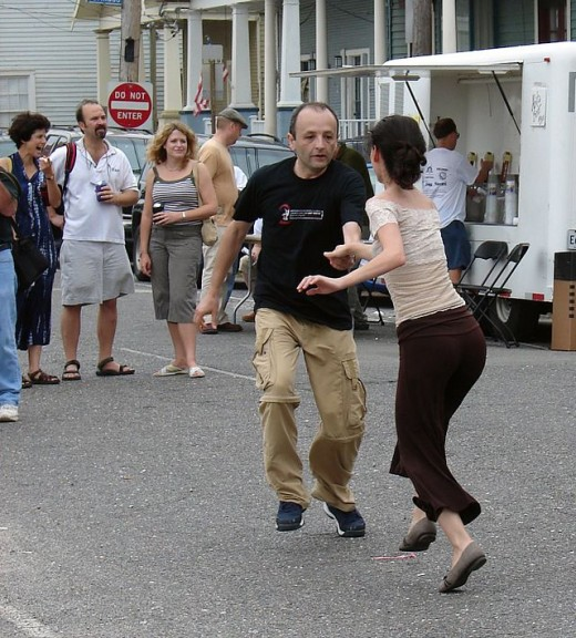 Dancing in the street, New Orleans - Photo by Howie Luvzus