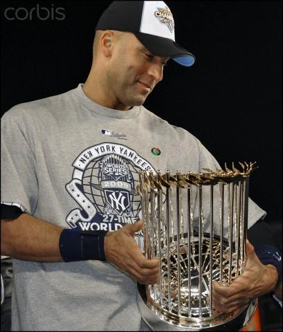 Now ex- New York Yankee, Derek Jeter holds World Championship Tropy for 2009