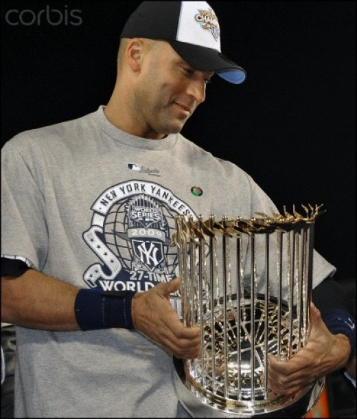 Now ex- New York Yankee, Derek Jeter holds World Championship Tropy for 2009