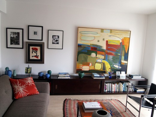A modern white walled living room with modern art wall decor offers a great focal point for any room.