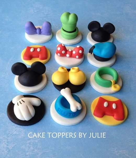 Simple yet very effective! Simple enough for you to make too, I'm sure. If you feel confident sculpting, you can make these toppers quite easily. Especially the ears, shoes and bows.  Give it a go!