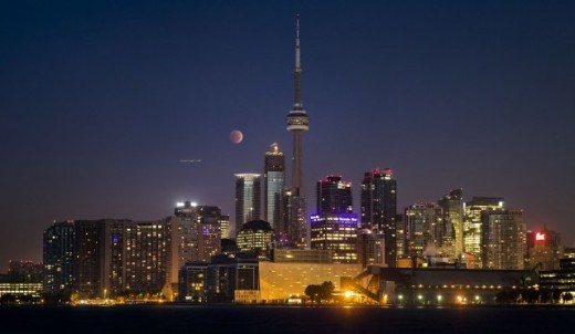 Lunar eclipse know as the blood moon seen above  the CN tower in Toronto, Cananda.