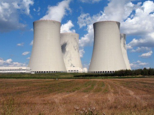 Concrete chimneys at a nuclear power plant.  Nuclear energy has long since been controversial.  Detractors highlight the possibilities for catastrophic accidents, plus the long term environmental damage caused by the waste disposal.