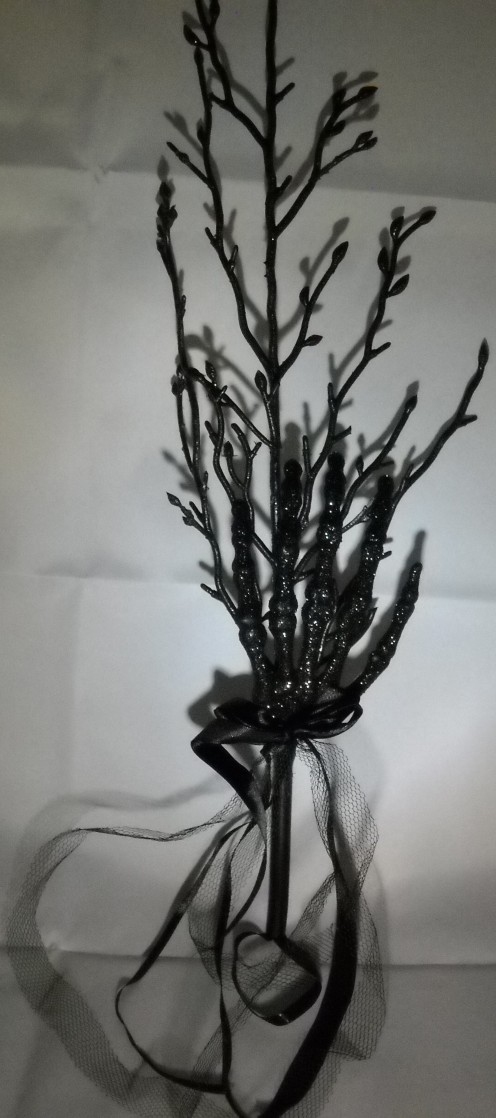 "2)  20"" Hanging glitter branch (with skeleton hand) -  This item comes in other colors, but black was chosen to give the centerpiece more of a Gothic look."