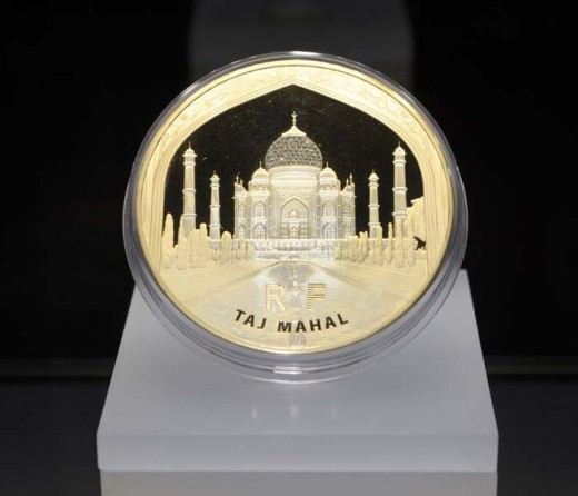The world-renowned Monnaie de Paris (Paris Mint) has unveiled a rare work of artistry – a gold coin bearing a Taj Mahal engraving – at their Manhattan showroom.The world's first one kilo gold coin to feature with 68 hand-set Cartier diamonds.