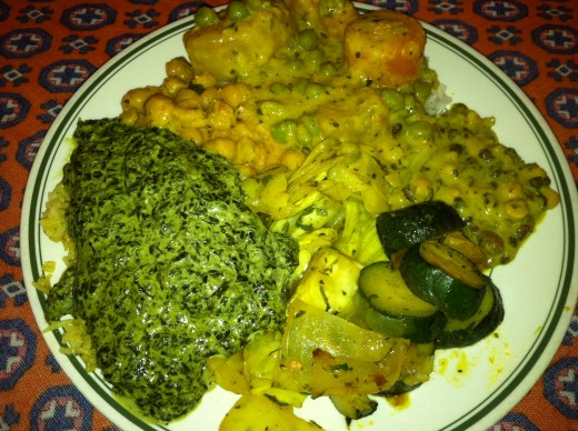 Indian Buffet with creamed spinach, zucchini, cabbage, and curried potatoes, peas, and carrots