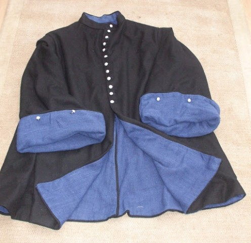 Togs are clothes or an outfit, which can be a type of coat.