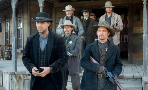 Russell Crowe (from left, wearing a black suit) and Christian Bale (back right, wearing a light brown jacket), both looking tough, out in the wild-wild-west.