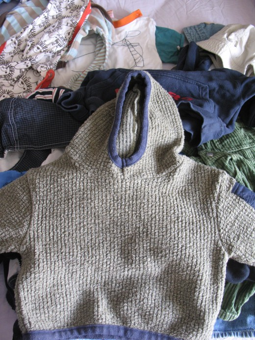 It's relatively easy to get hold of second hand and mostly free baby clothes.