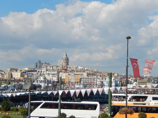 The White Flags are actually where the bridge is. The tower in the middle in the background is the Galata Tower.