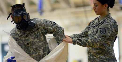 Troops putting on protective gear for West Africa