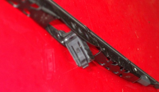 An unattached wiper blade at the center where it will be attached.