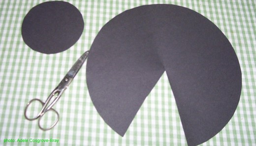 Cut out two circles for your witch.