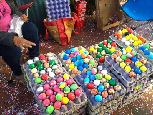 The confetti eggs are colorful eggshells filled with confetti.  These confetti eggs are sold on street corners of the Fiesta.  They are tossed at each other to intensify the celebration.