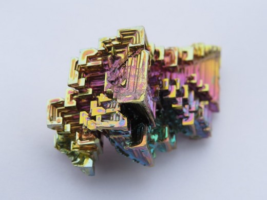 This Bismuth crystal is not a mineral because it was not created naturally.