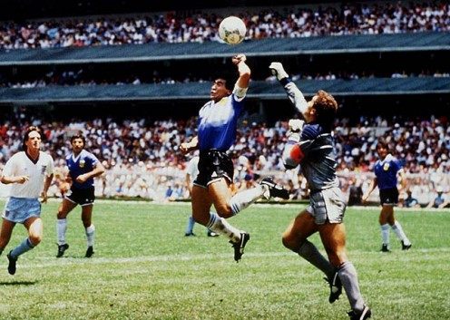"Diego Maradona's ""Hand of God"" helps Argentina beat England in Mexico City in 1986."